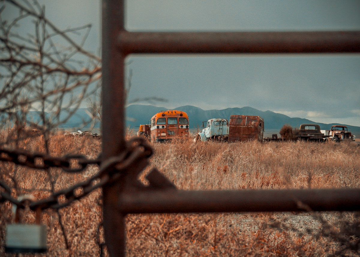 Photo: fenced off and forgotten vehicles near White Sands