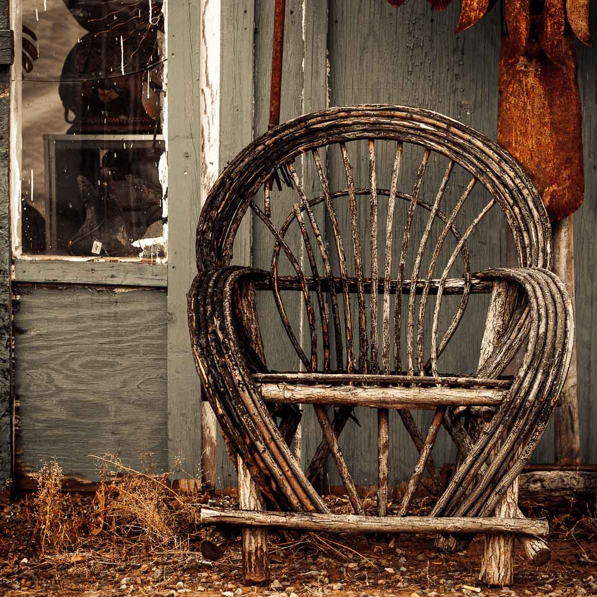 Photo: old wicker chair at Tesuque Pueblo Flea Market