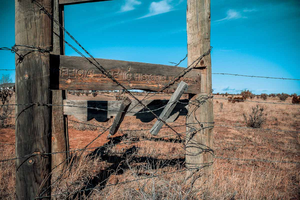 Photo: Official Scenic Historical Marker wrapped in barbed wire, Turner Inn & RV Park, New Mexico
