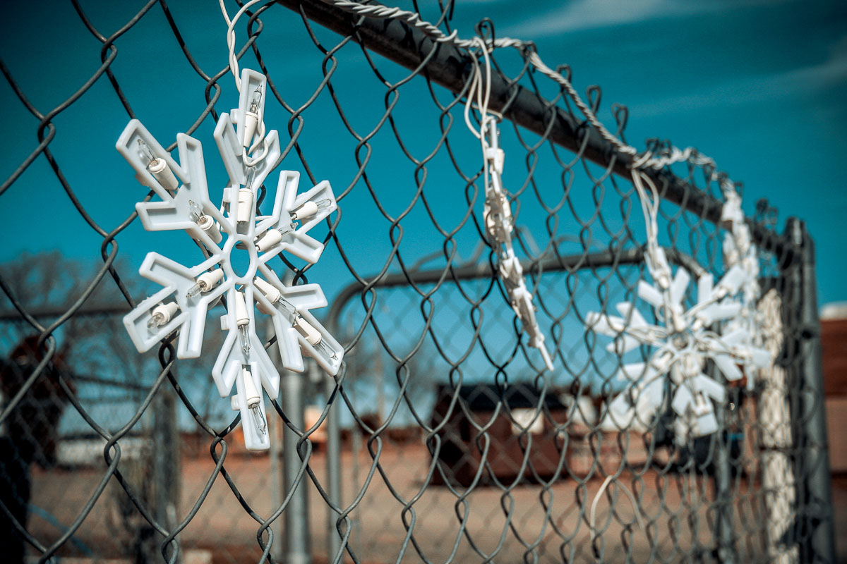 Photo: Christmas lights and chainlink fence, Turner Inn & RV Park, New Mexico
